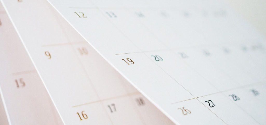 calendar-page-flipping-sheet-close-up-blur-background-business