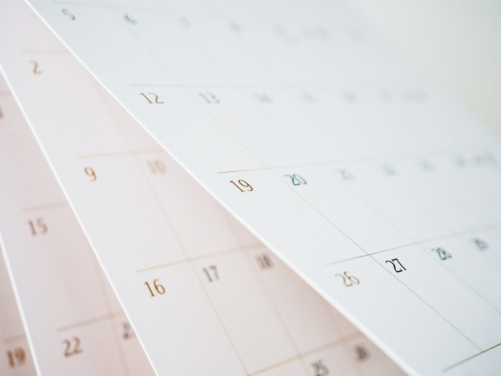 calendar-page-flipping-sheet-close-up-blur-background-business